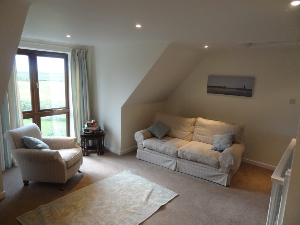 Spacious living room with view of Blakeney Point